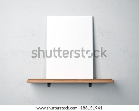 white poster on a shelf - stock photo