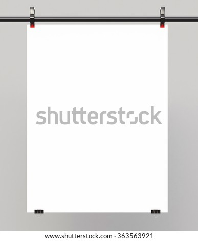 white poster sandwiched metal clasps on wall - stock photo