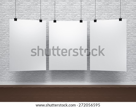 white posters on brick wall - stock photo