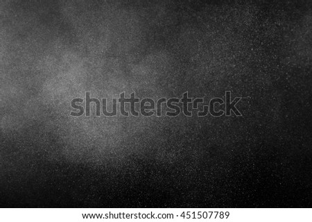White powder explosion on black background. Abstract  dust texture.