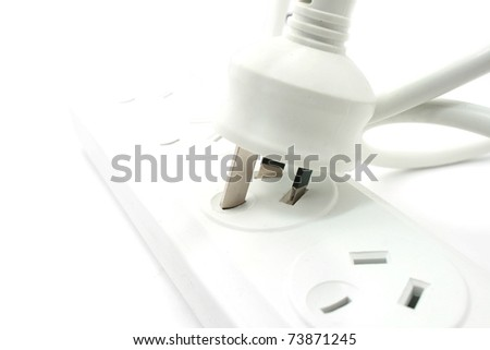 White Power extension board with plug isolated on white - stock photo