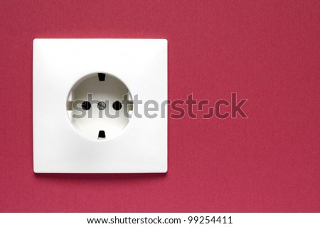 White power socket on a red wall - stock photo