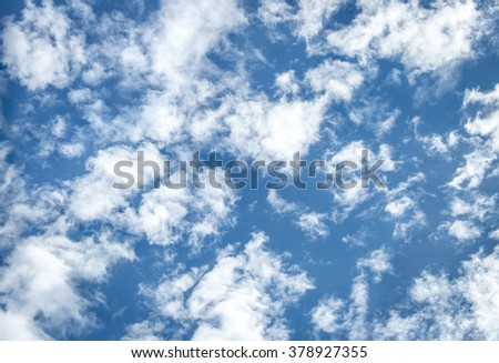 White puffy clouds on the background blue sky - stock photo