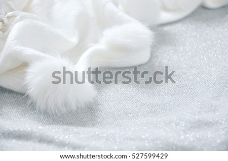 White puffy scarf on grey glitter background