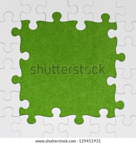 White Puzzle Frame on green Background - stock photo