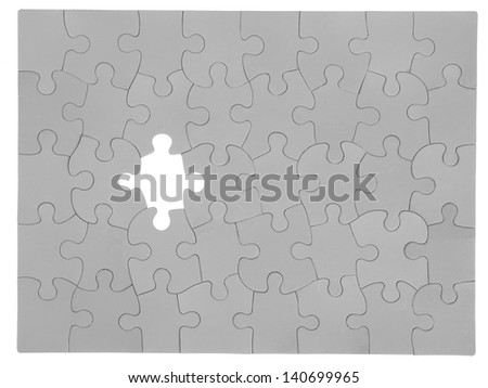 White puzzle in a card board