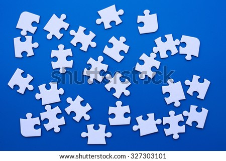 white puzzle on blue table