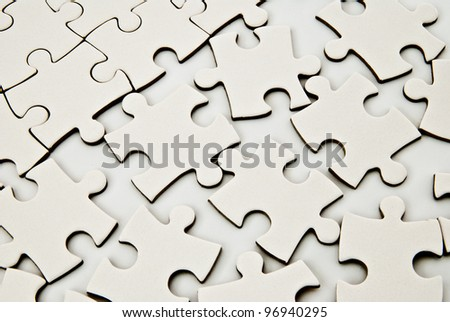 white puzzle pieces as a background - stock photo
