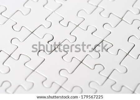 white puzzle, teamwork and connection - stock photo