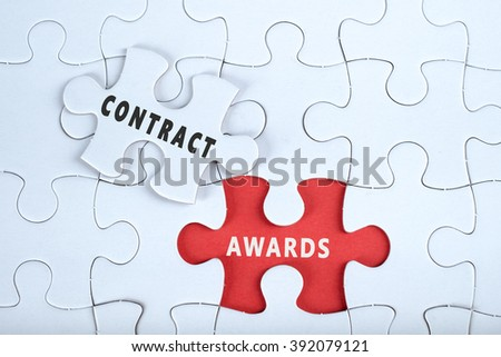 White puzzle with the word CONTRACT & AWARDS, contract management conceptual - stock photo