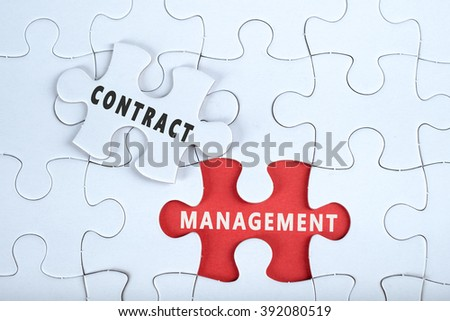 White puzzle with the word CONTRACT & MANAGEMENT, contract management conceptual - stock photo