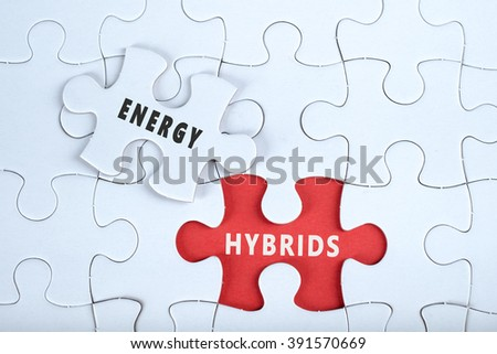White puzzle with the word ENERGY & HYBRIDS - stock photo