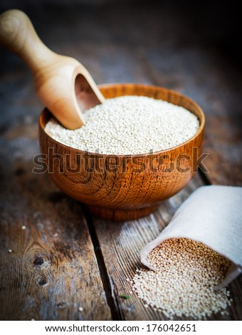 White quinoa on rustic wooden background - stock photo