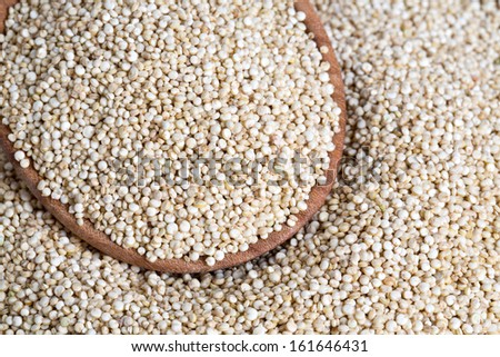 white quinoa on wooden background