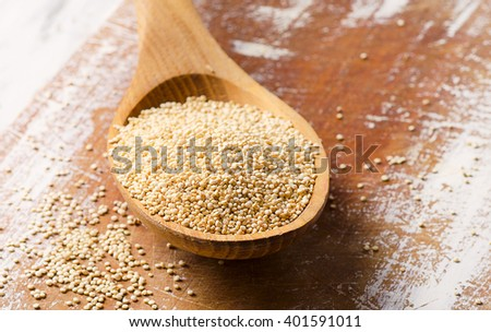 White quinoa seeds on a wooden Table. Selective focus