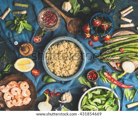 White quinoa with various vegetables for tasty cooking.  Healthy food ingredients with cooked quinoa, on dark rustic background, top view.  Superfood , healthy eating or vegetarian food concept. - stock photo