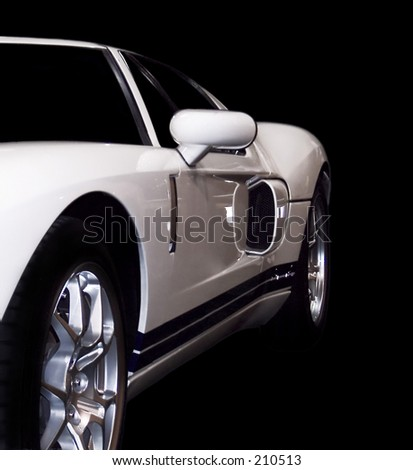 White racing car isolated on black.