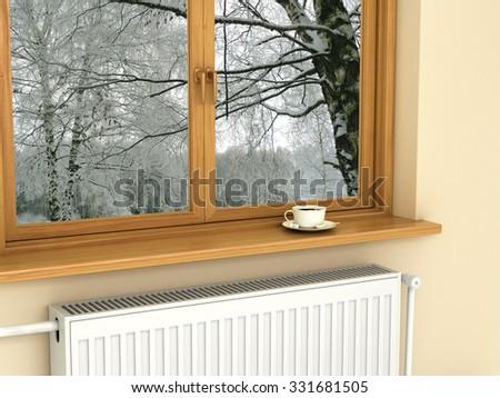 White radiator near the window, warm and cozy - stock photo