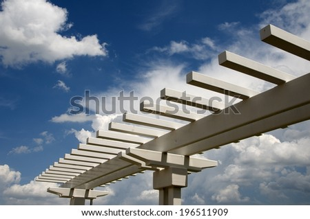 White rails with a cloudy sky for the background. - stock photo