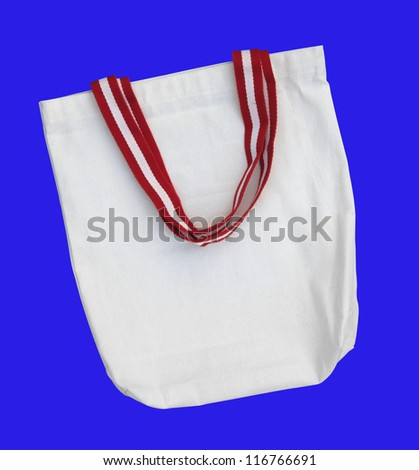 White raw cotton bag with color handle on blue screen isolated background path included.