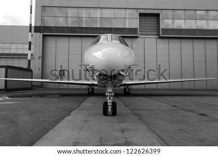 White reactive private jet, front landing gear