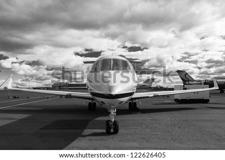White reactive private jet, the front landing gear - stock photo