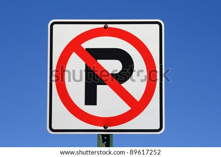 white red and black no parking sign with blue sky background - stock photo