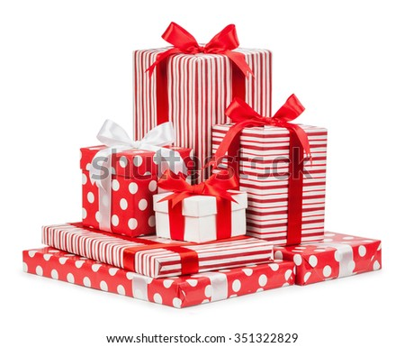 White, red and striped boxes with gifts tied bows on white background. - stock photo