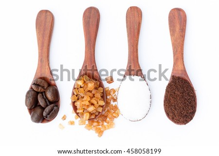 White, red sugar and coffee powder in wooden spoon on white background. - stock photo