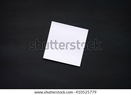 white reminder sticky note on black board.(blank post it note) flat lat.  - stock photo