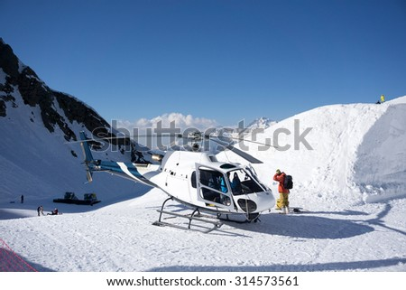 White rescue helicopter parked in the snowy mountains