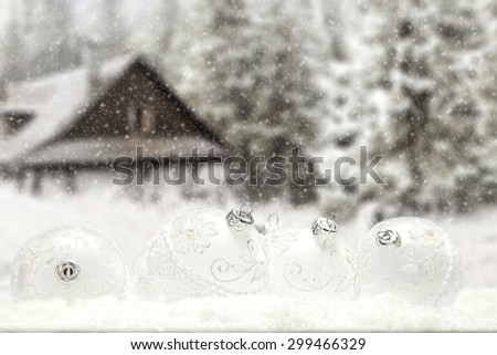 white retro balls on snow and forest of winter  - stock photo