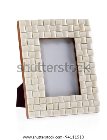 White retro table picture frame made out of plastic - stock photo