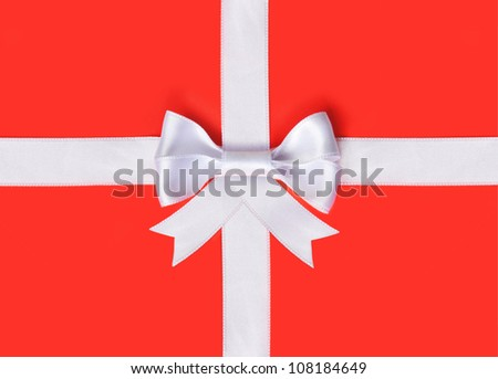 White ribbon on a red background - stock photo
