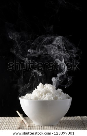 White rice bowl with chopsticks - stock photo