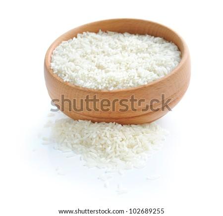 White rice on wooden bowl - stock photo