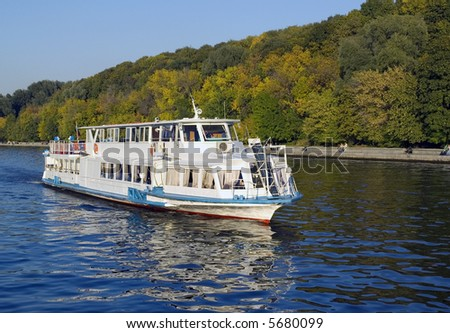 White river boat with forest background at the autumn season - stock photo