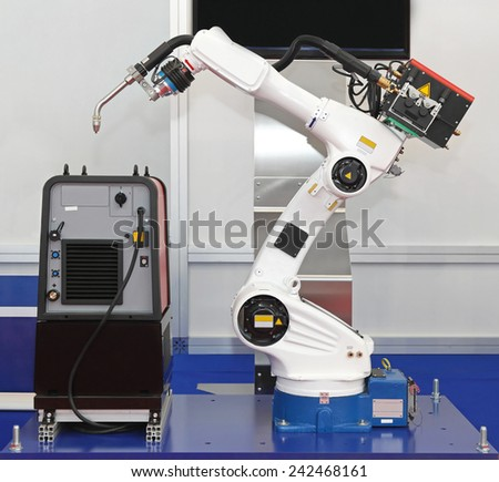 White robotic arm for welding in factory - stock photo
