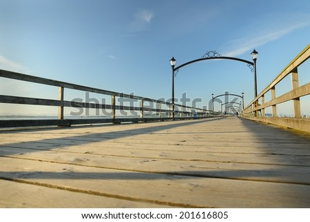 White Rock Pier, BC. Early morning on the White Rock pier, a popular tourist destination on the west coast of British Columbia near the United States border.  - stock photo