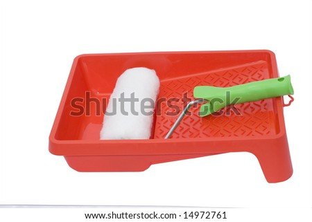 White roller on red surface isolated over white - stock photo
