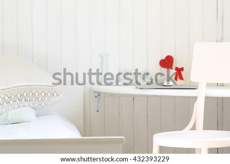 white romantic bedroom in a rustic wooden house workplace - stock photo