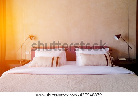 White Room in luxury hotel illuminated by sunlight - stock photo