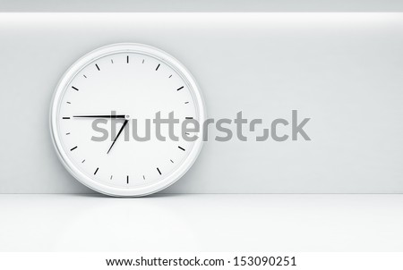 white room with large wall clock - stock photo