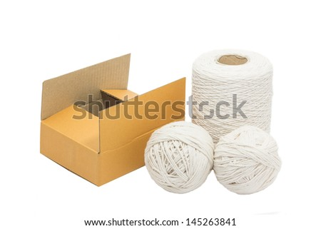 white rope and empty box are equipment for packing the box - stock photo