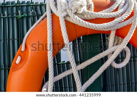 White rope and float in the lifeguard post of a swimming pool - stock photo