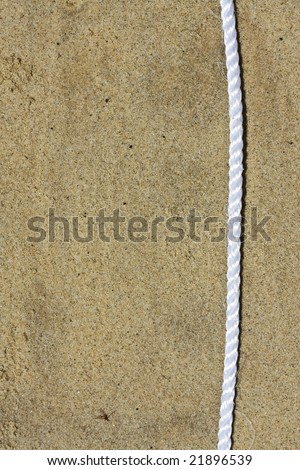 white rope on sand texture - stock photo