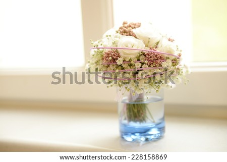 White rose bouquet by the window - stock photo