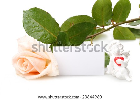 White rose, figurine and blank card for your text. Valentines day card.