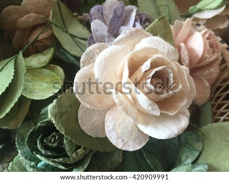 White rose flowers in mulberry paper texture with lighting at morning - stock photo