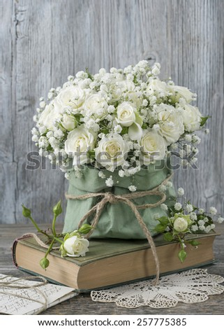 White roses and a book - stock photo